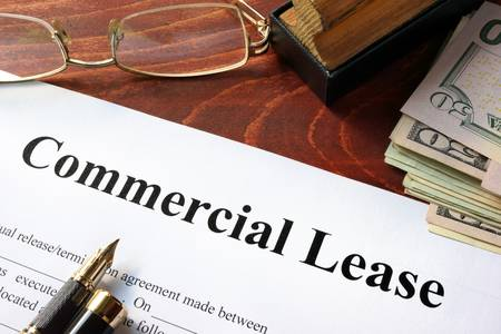 60527095-commercial-lease-agreement-with-money-on-a-table-